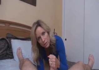 Filthy as fuck mom gives a good handjob for a son