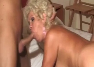 Busty blonde mom eats two cocks of her sons